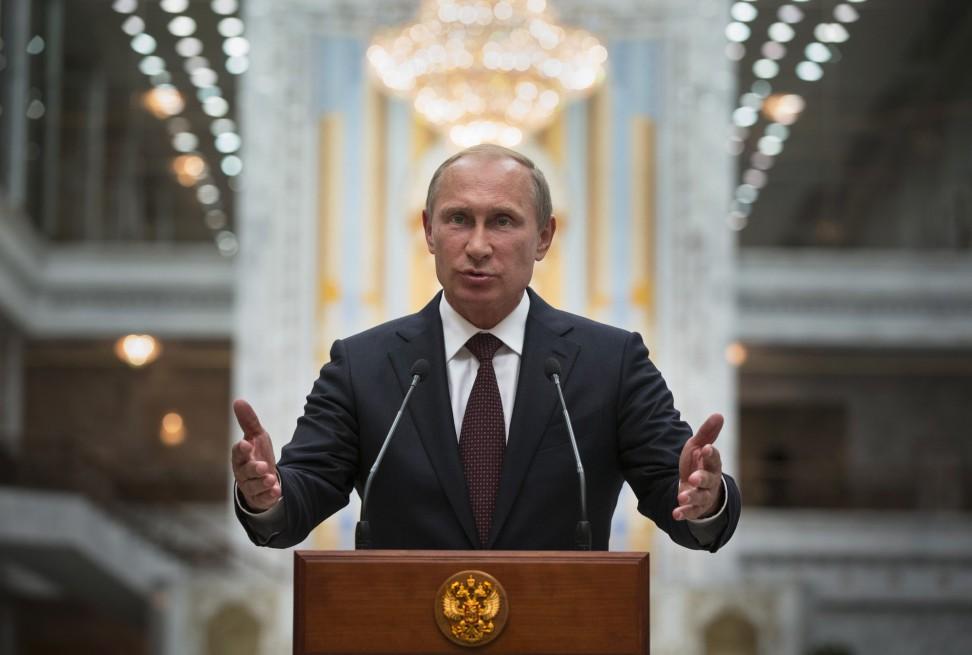 Russian President Putin speaks to the media after talks with Ukrainian President Poroshenko in Minsk