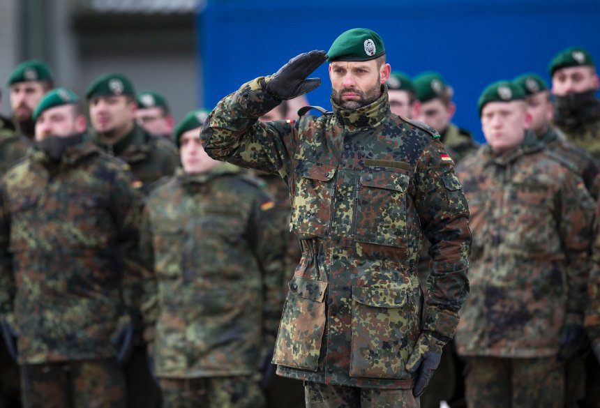 German Bundeswehr soldiers of the 12th Mechanised Infantry Brigade, 122th Infantry Battalion take part in a NATO enhanced forward presence battalion welcome ceremony at the Rukla military base some 130 km (80 miles) west of the capital Vilnius, Lithuania, Tuesday, Feb. 7, 2017. The NATO enhanced forward presence battalion in Lithuania will be led by framework nation Germany. (AP Photo/Mindaugas Kulbis)